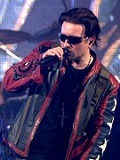 Een foto van de lookalike en imitator van  Bono